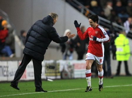 Nasri goes to his manager after scoring the 2nd goal